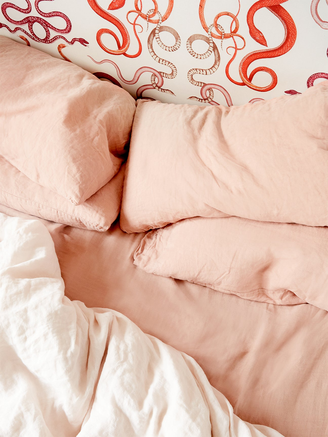 Pink bedding on bed