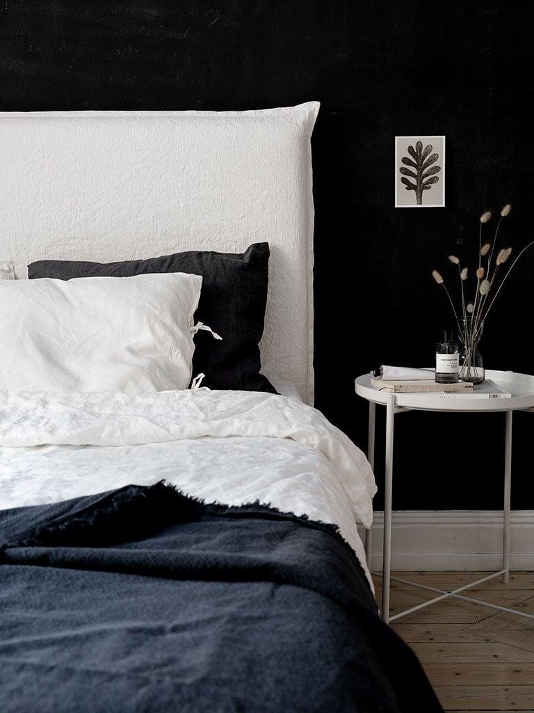 black bedroom with white headboard