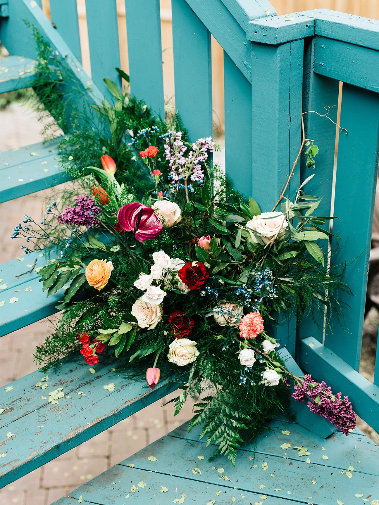 colorful flowers against blue staircase