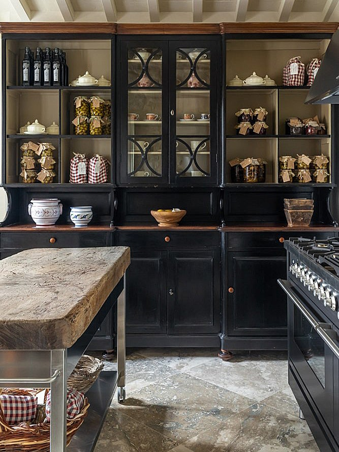 black kitchen with lots of glass doors