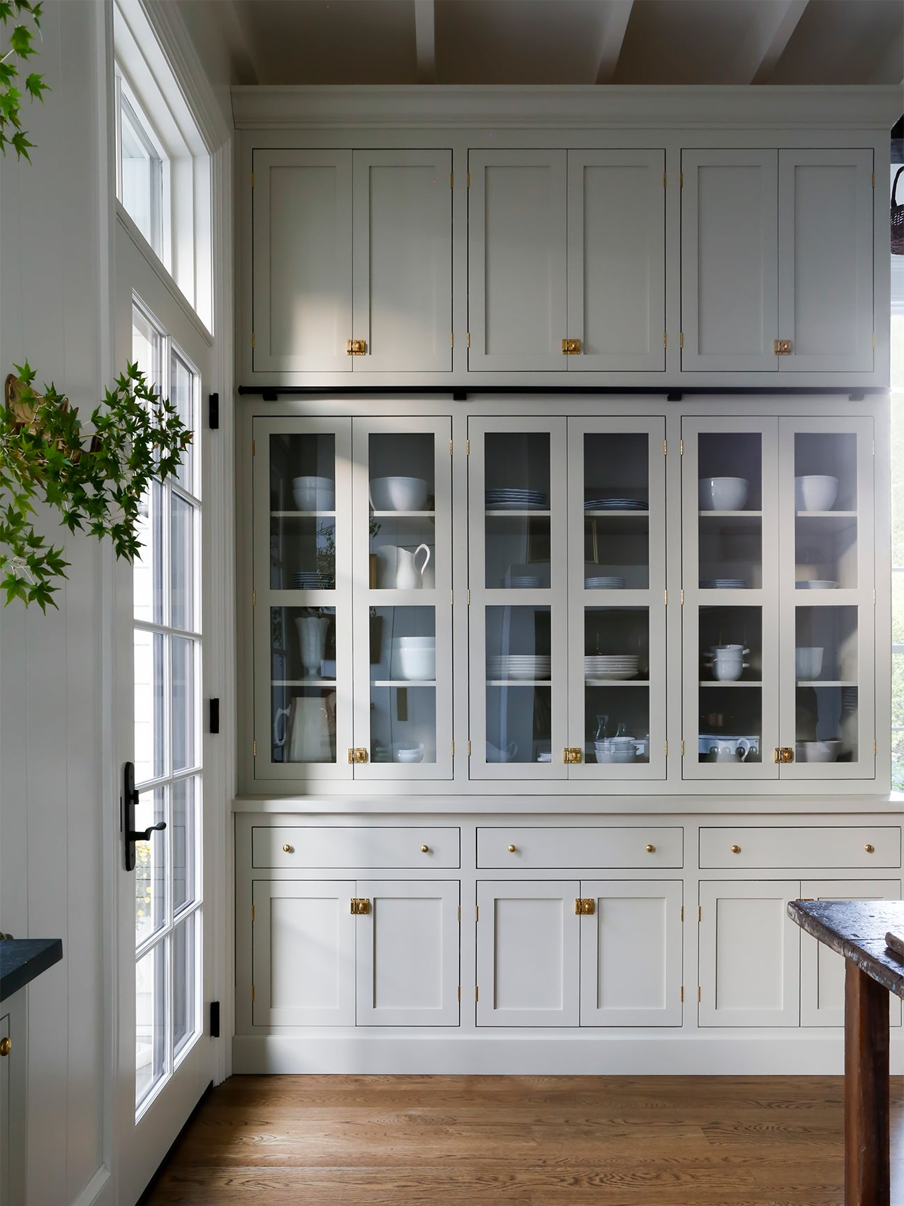 floor to ceiling glass cabinets