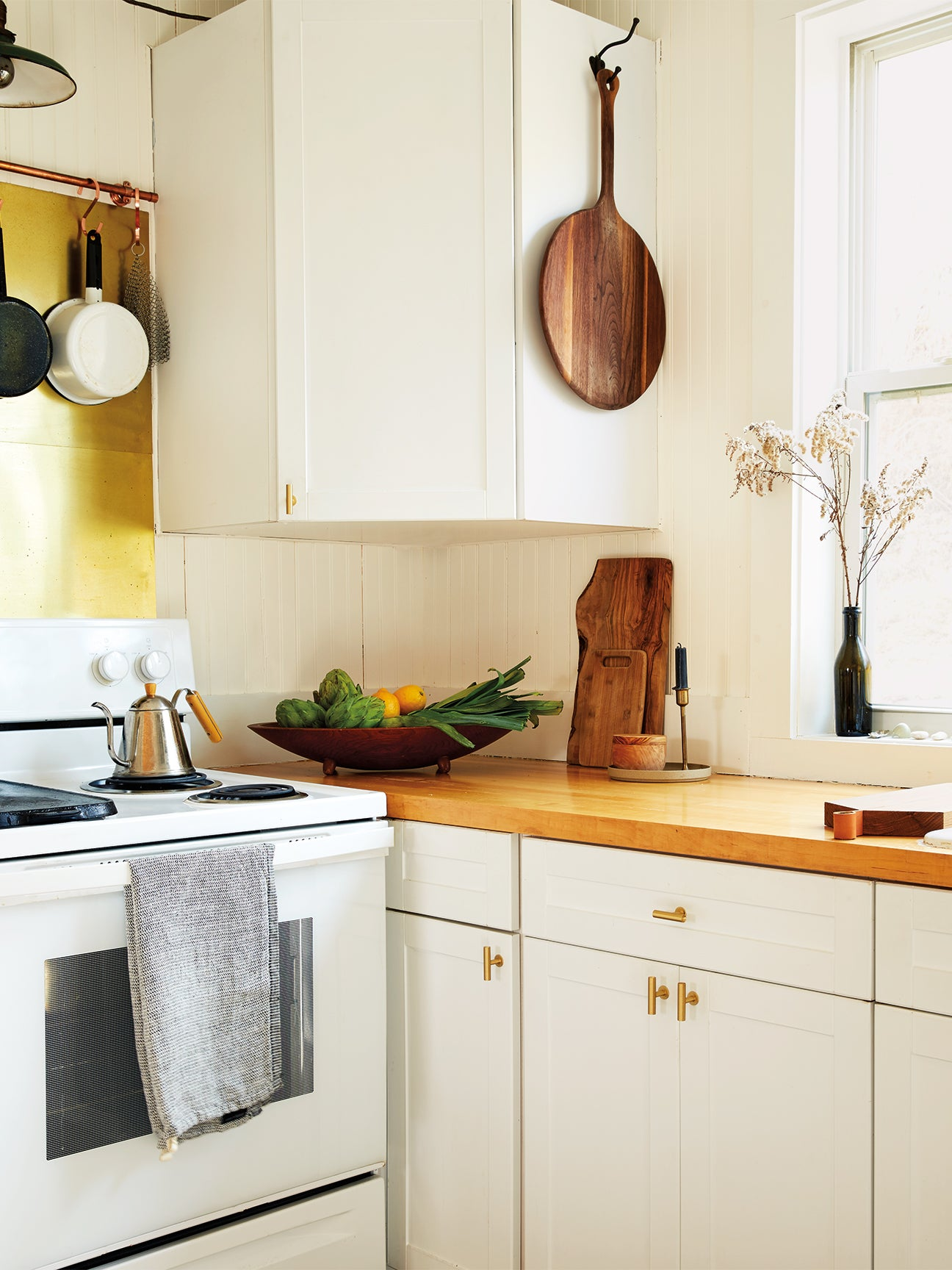tiny kitchen with butcher block counter