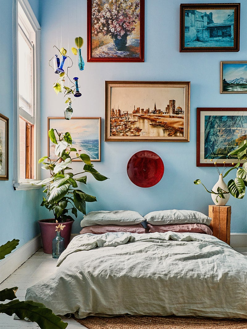 Colorful room with blue walls and bed on the floor