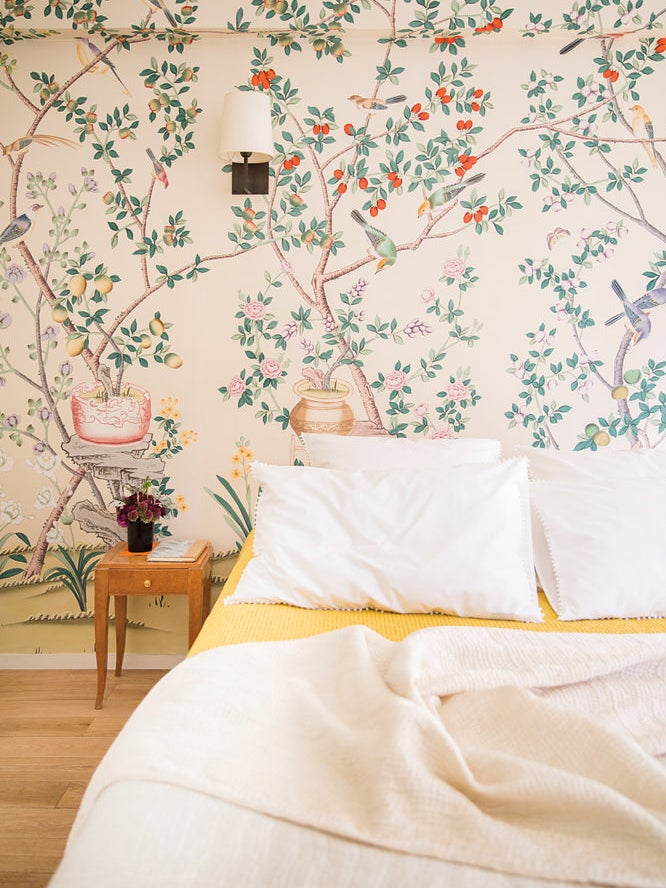 Room with floral wallpaper and bed on the floor