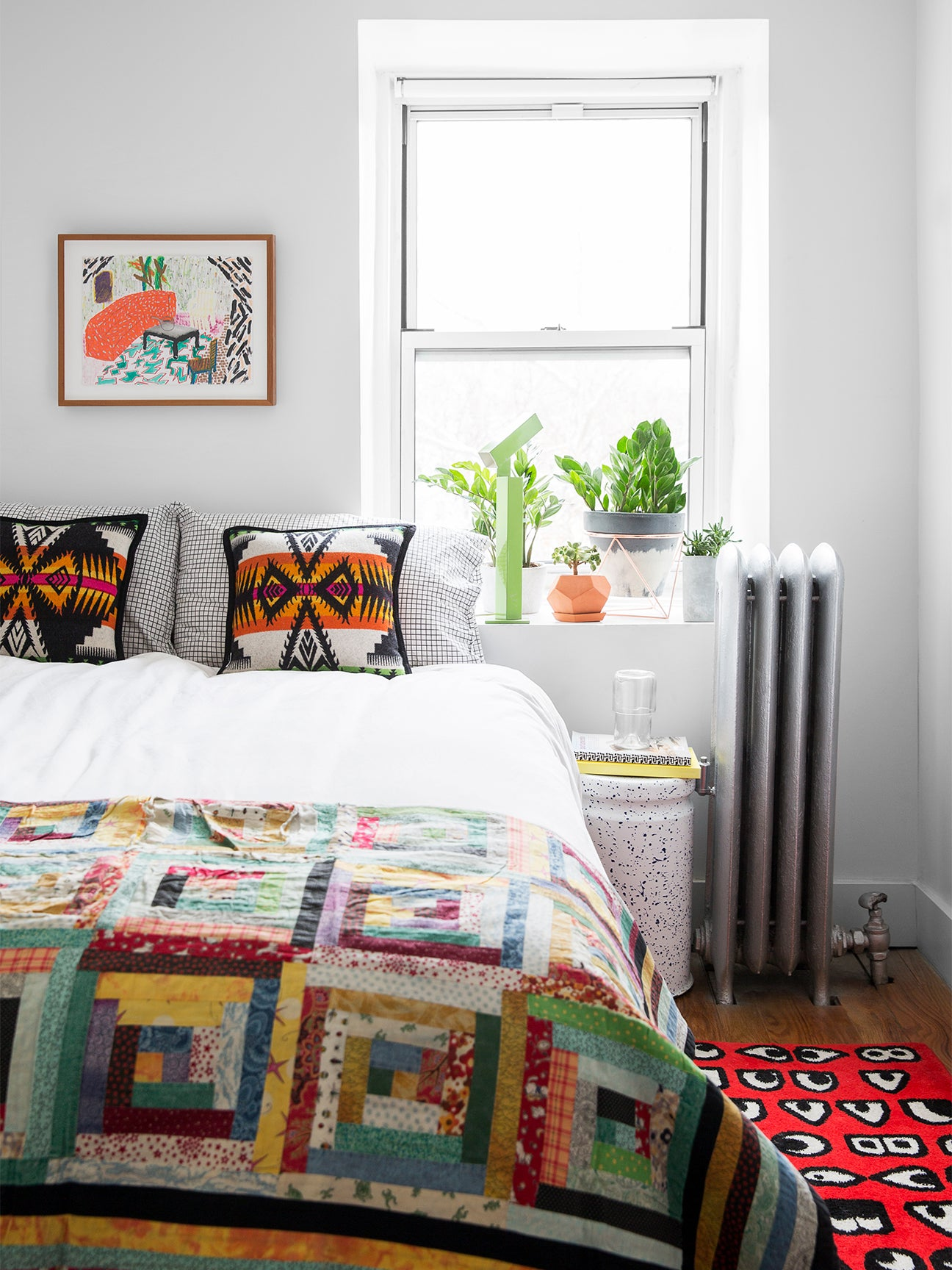 bedroom with colorful quilt