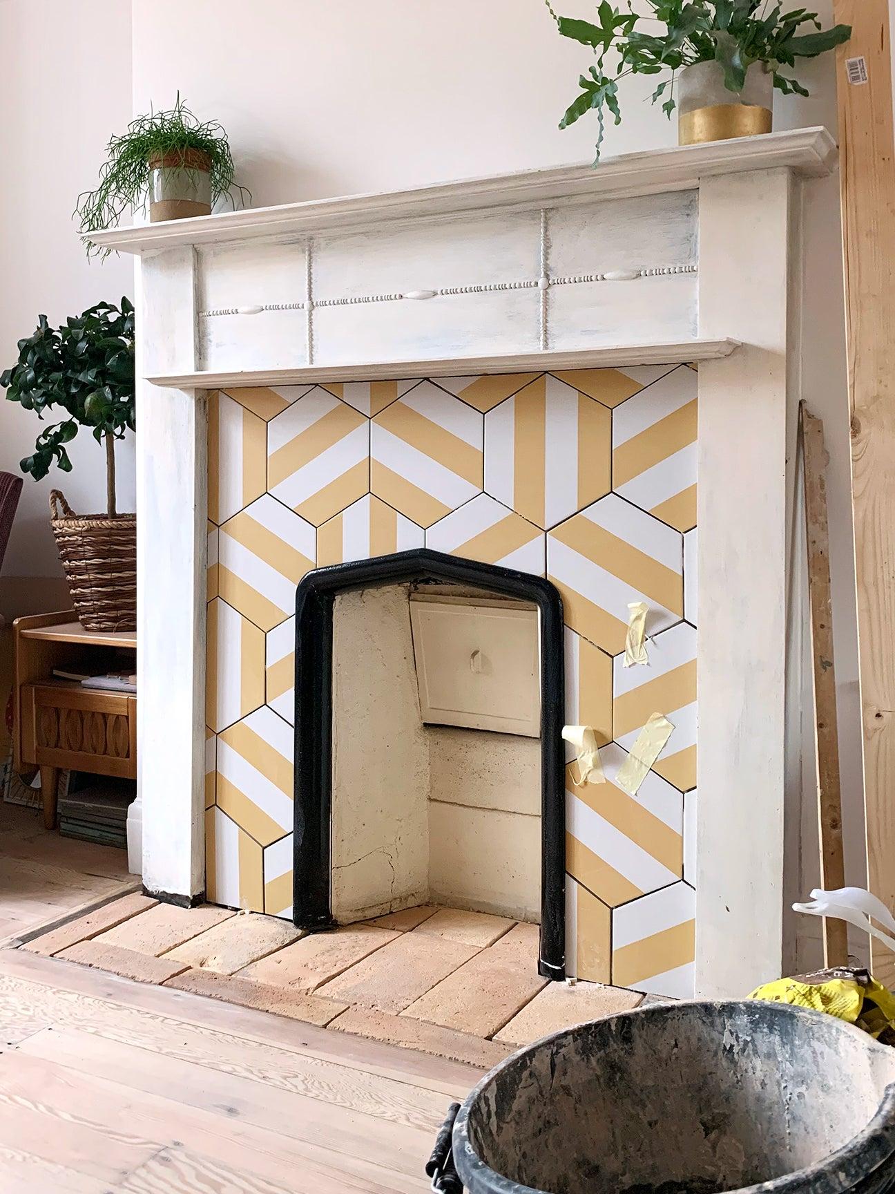 fireplace renovation yellow tiles