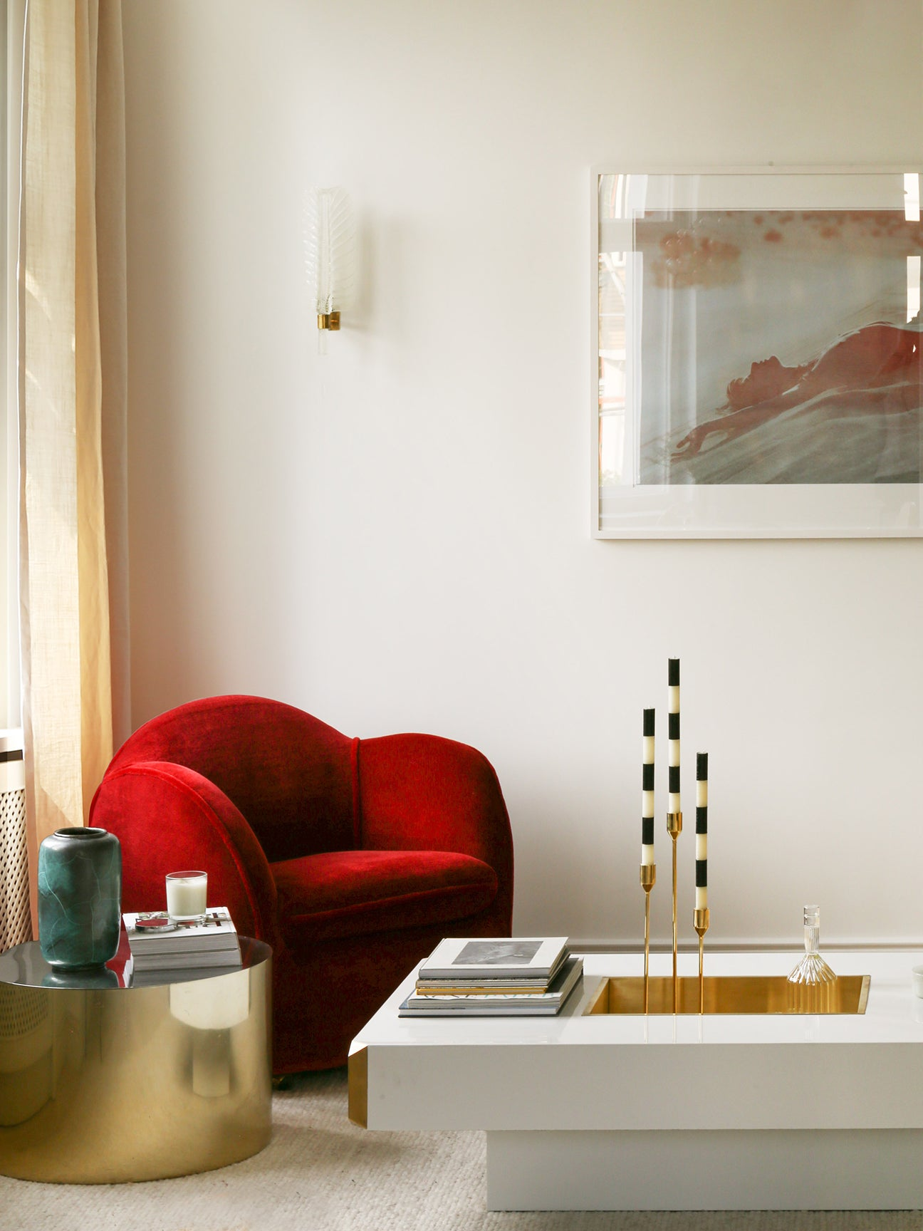 living room nook with red chair