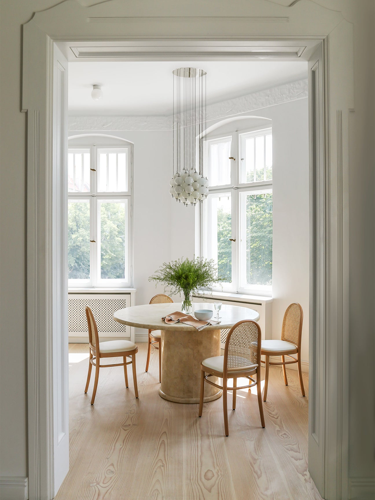 dining room nook with wooden chairs