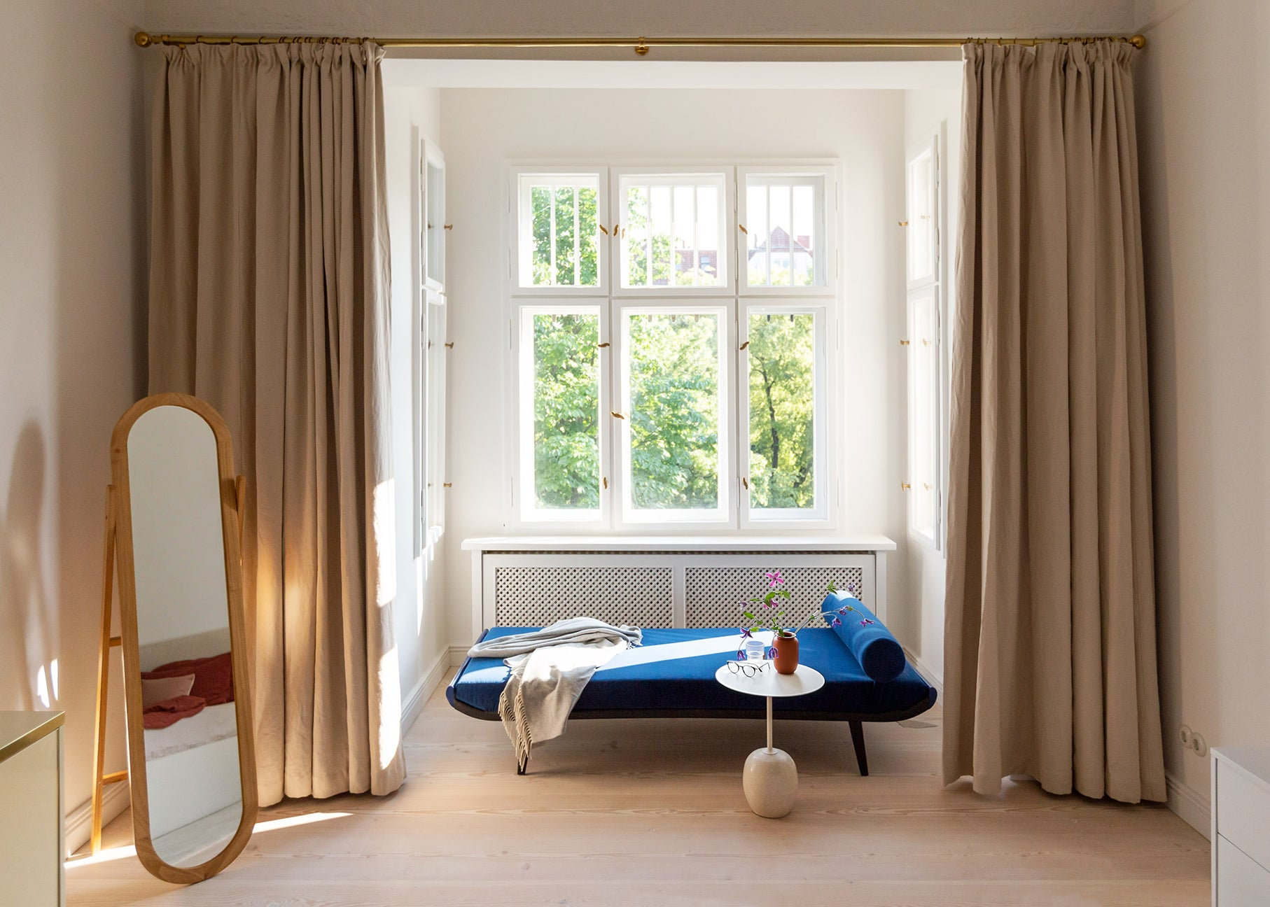 window nook with blue chaise