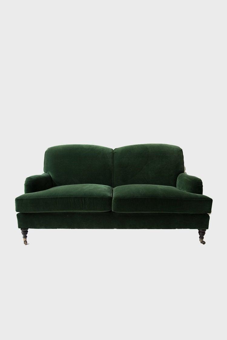 green_velvet_sofa