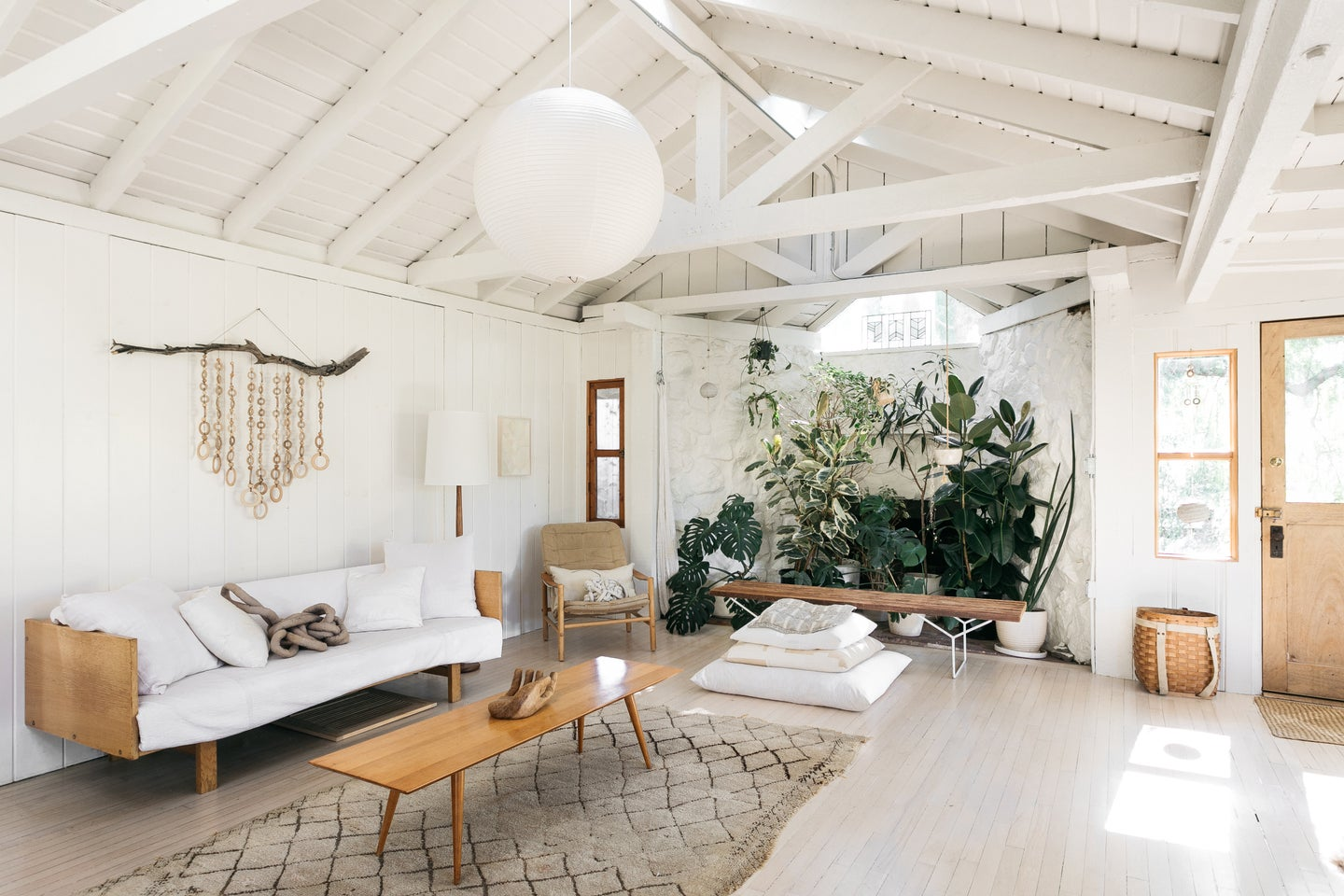 open and airy living room with white wood beams