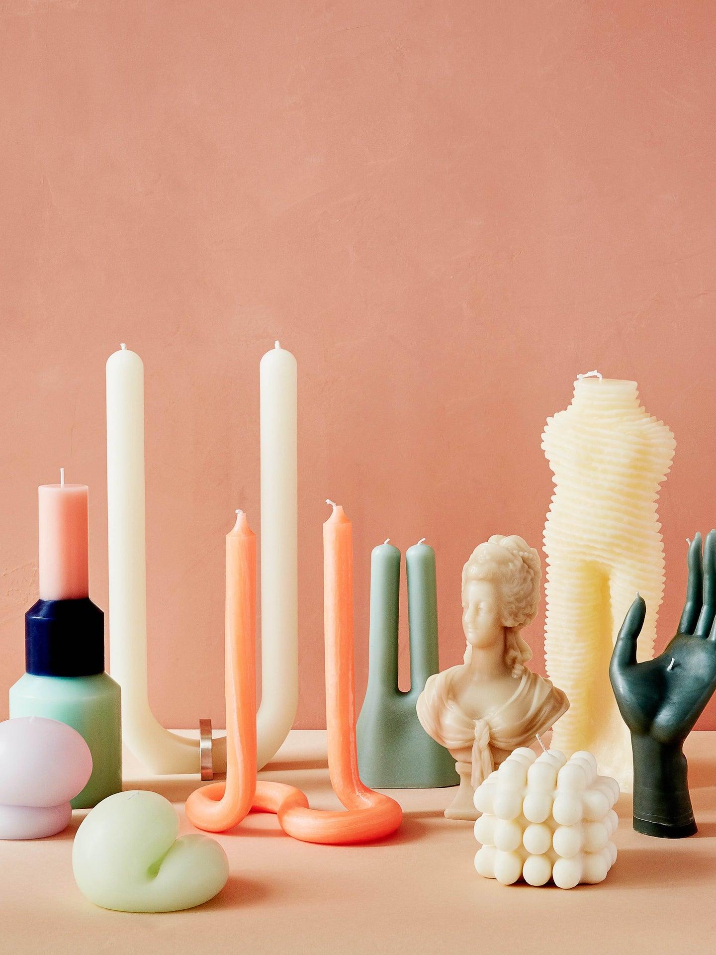 arrangement of uniquely shaped candles
