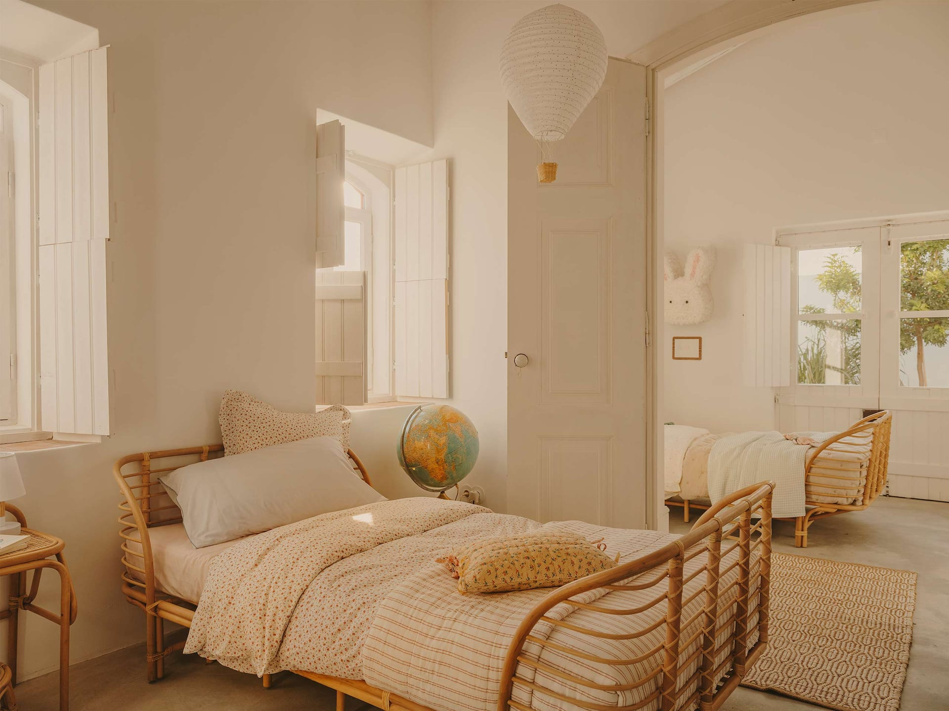 kids room in earthy colors and rattan bed