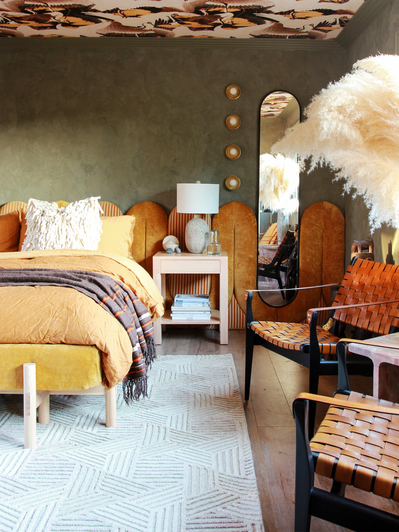 colorful bedroom with ochre headboard