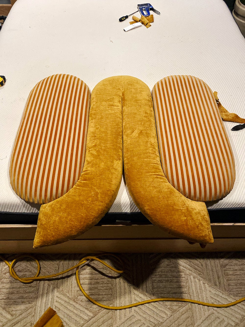 oval boards covered in ochre fabric