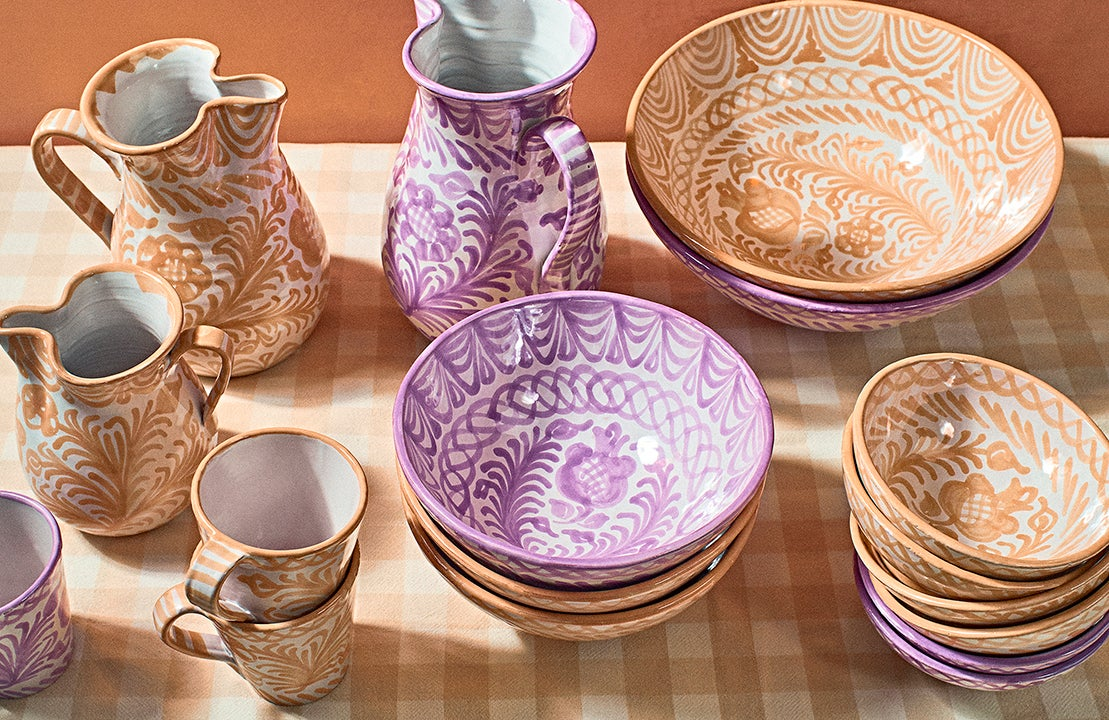 peach and lilac pottery on checkered tablecloth