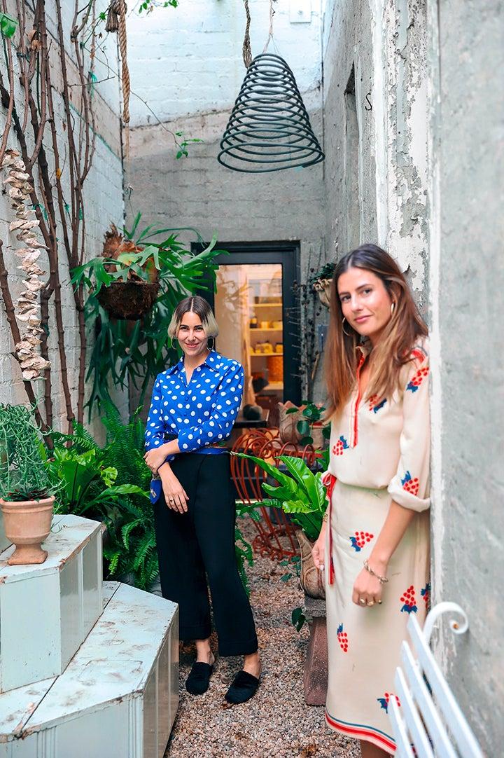 portrait of two women in doorway outside