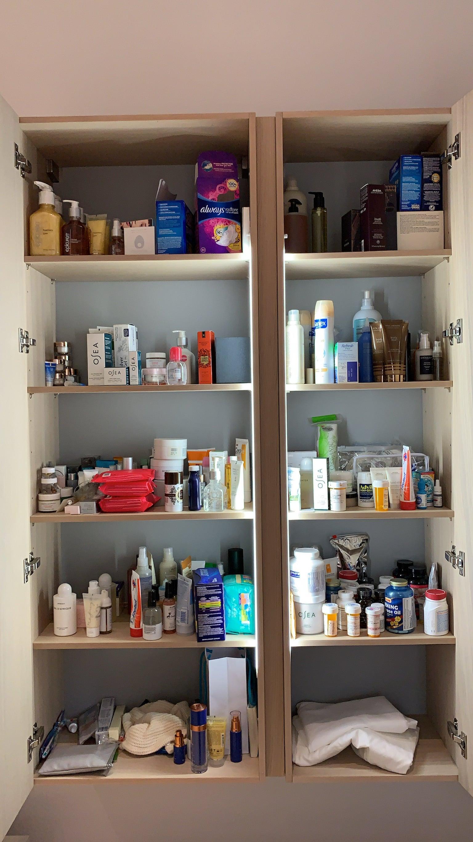 dark and unorganzied beauty cabinet