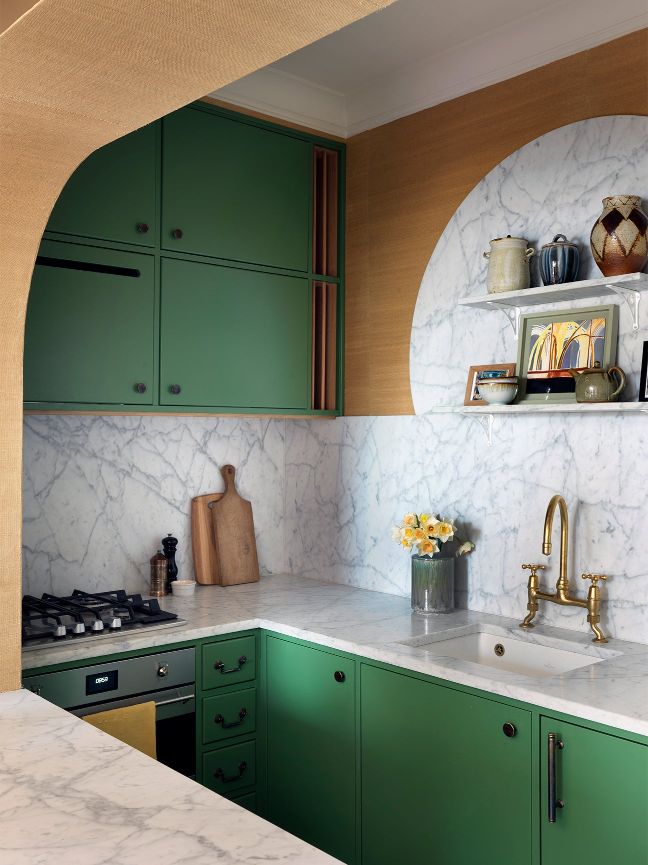 Small kitchen with green cabinets