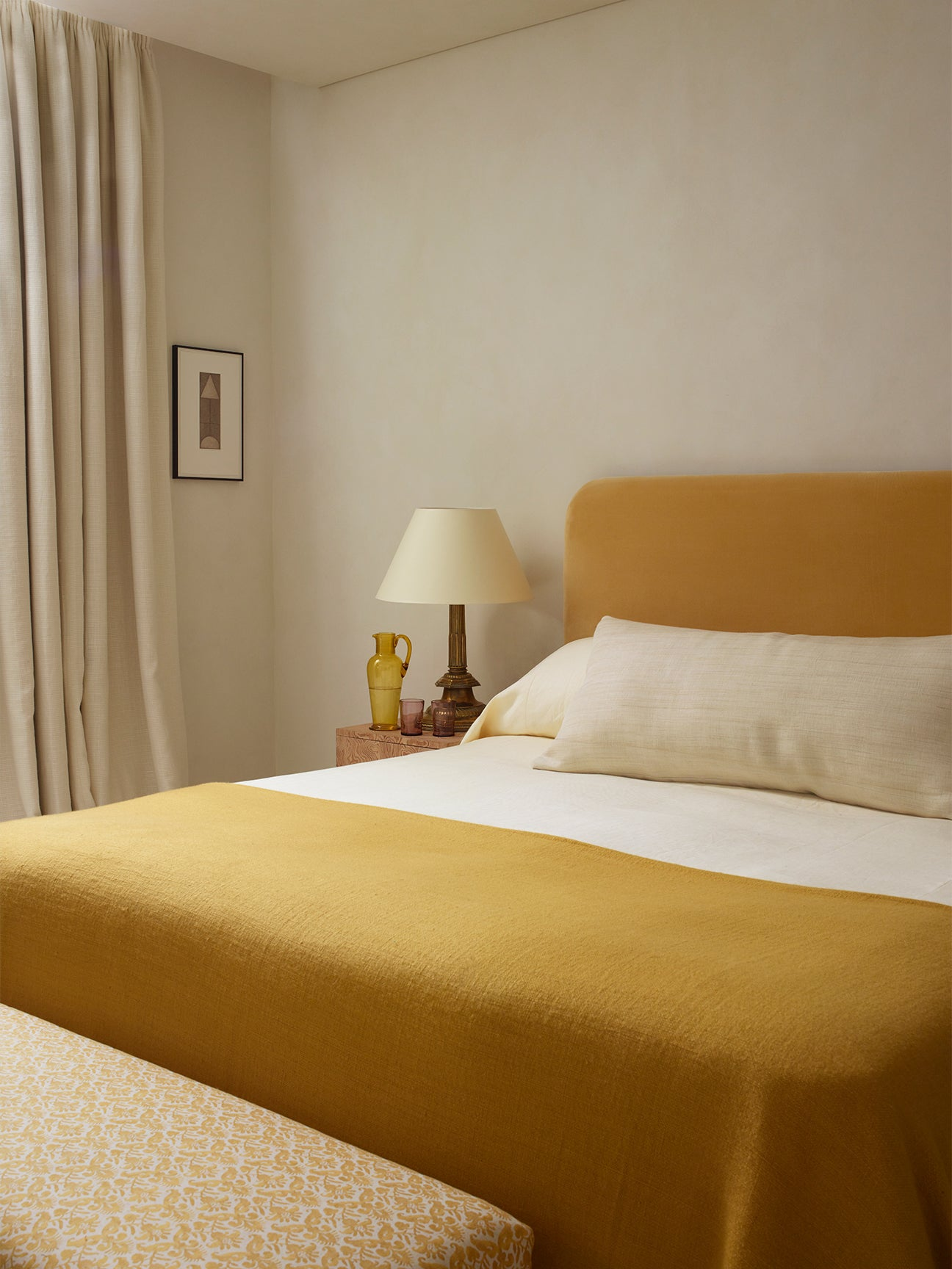 Minimalist bed with matching yellow headboard and quilt
