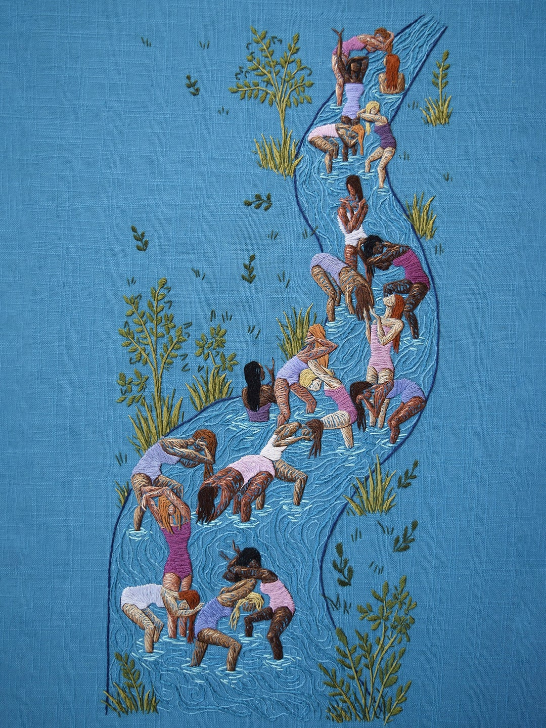 Embroidery art of women in a stream
