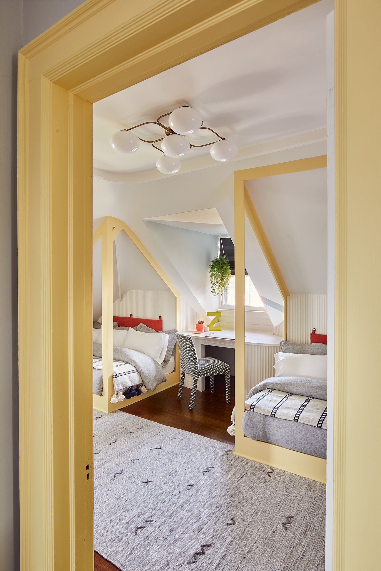 Attic Kids Room With Yellow Canopy Beds