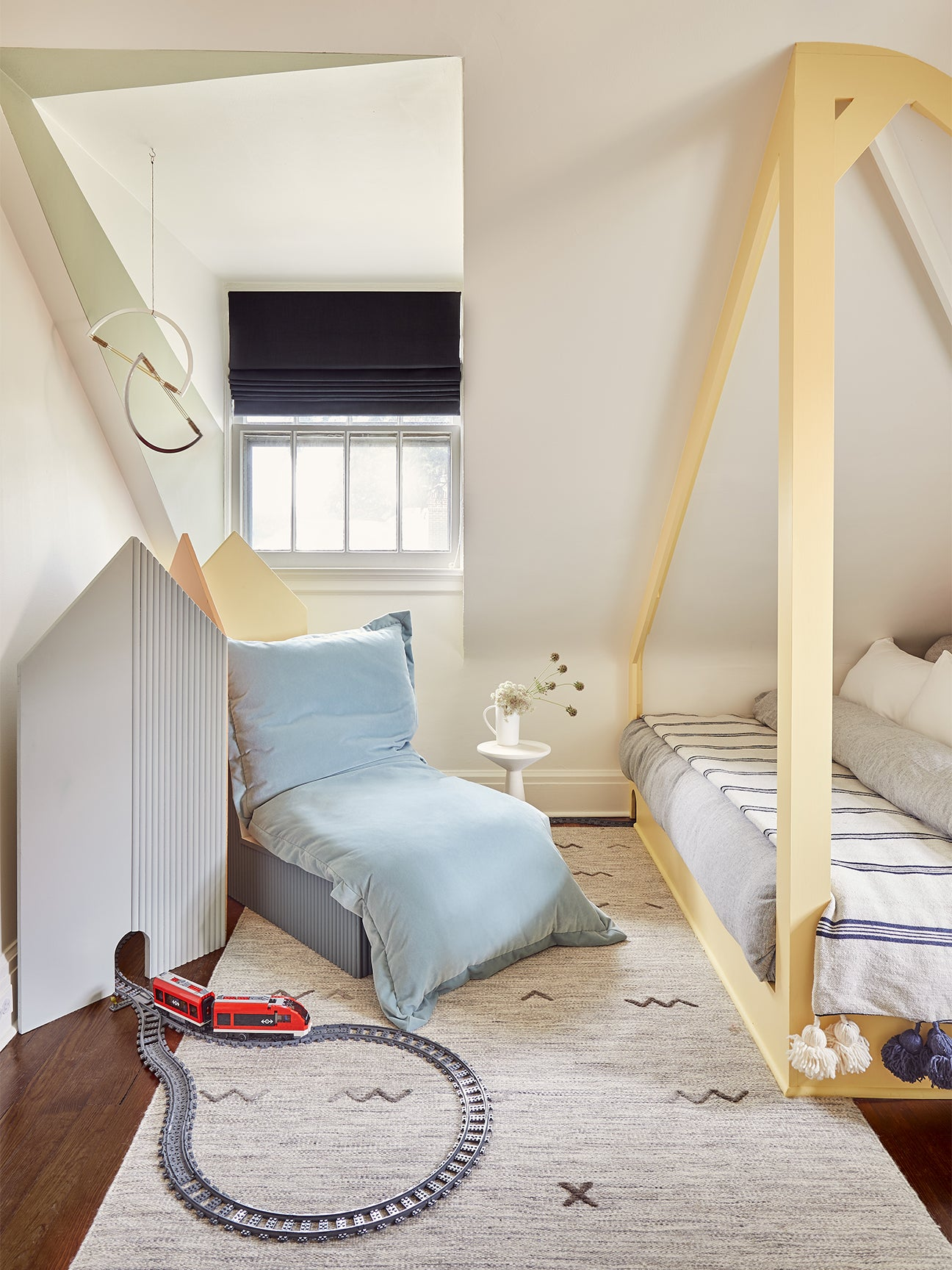 Attic Kids Room With Blue Slipper Chair
