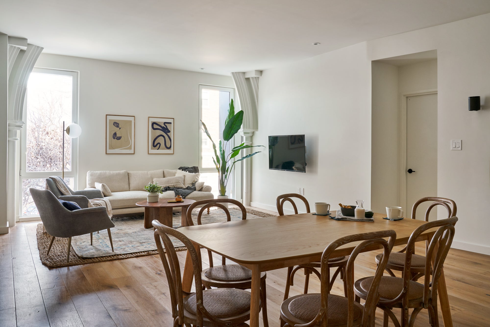 modern open dining room with wood table