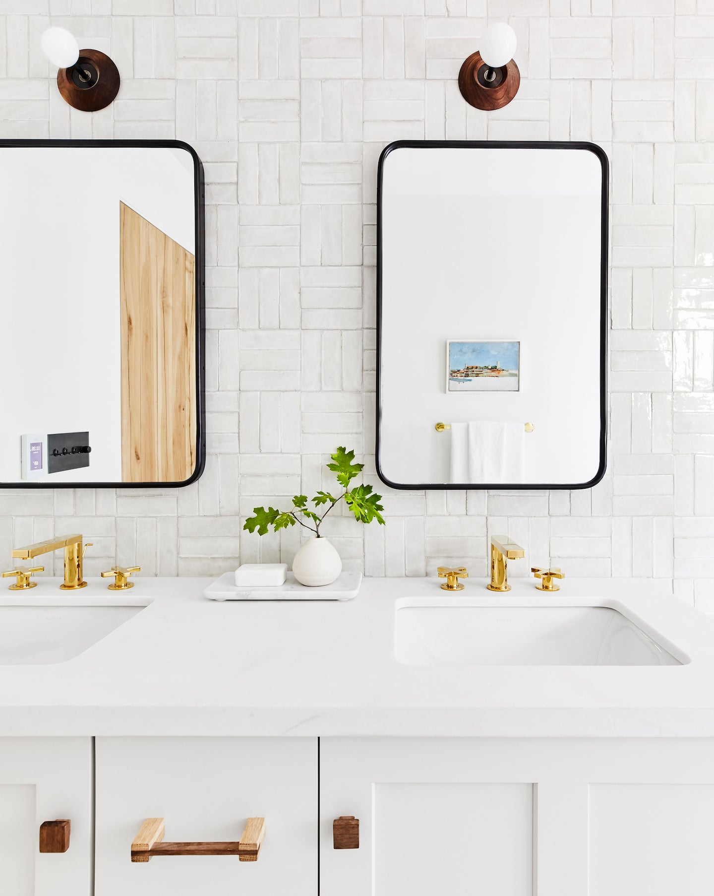 White bathroom with brass fixtures