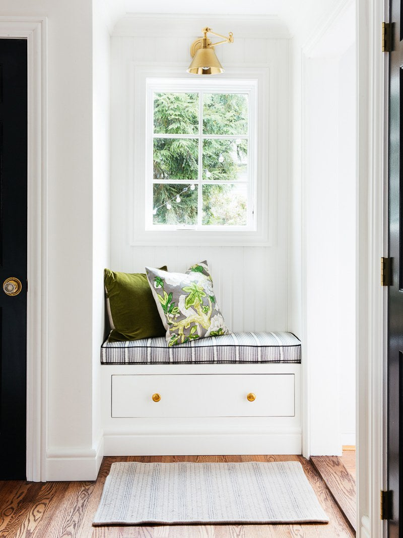 whtie beadboard walls with striped cushion