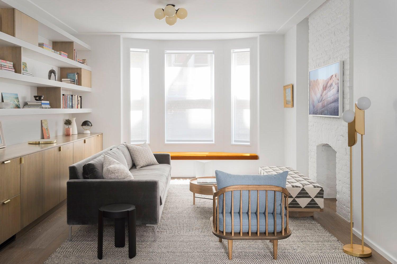 living room with orange window cushions