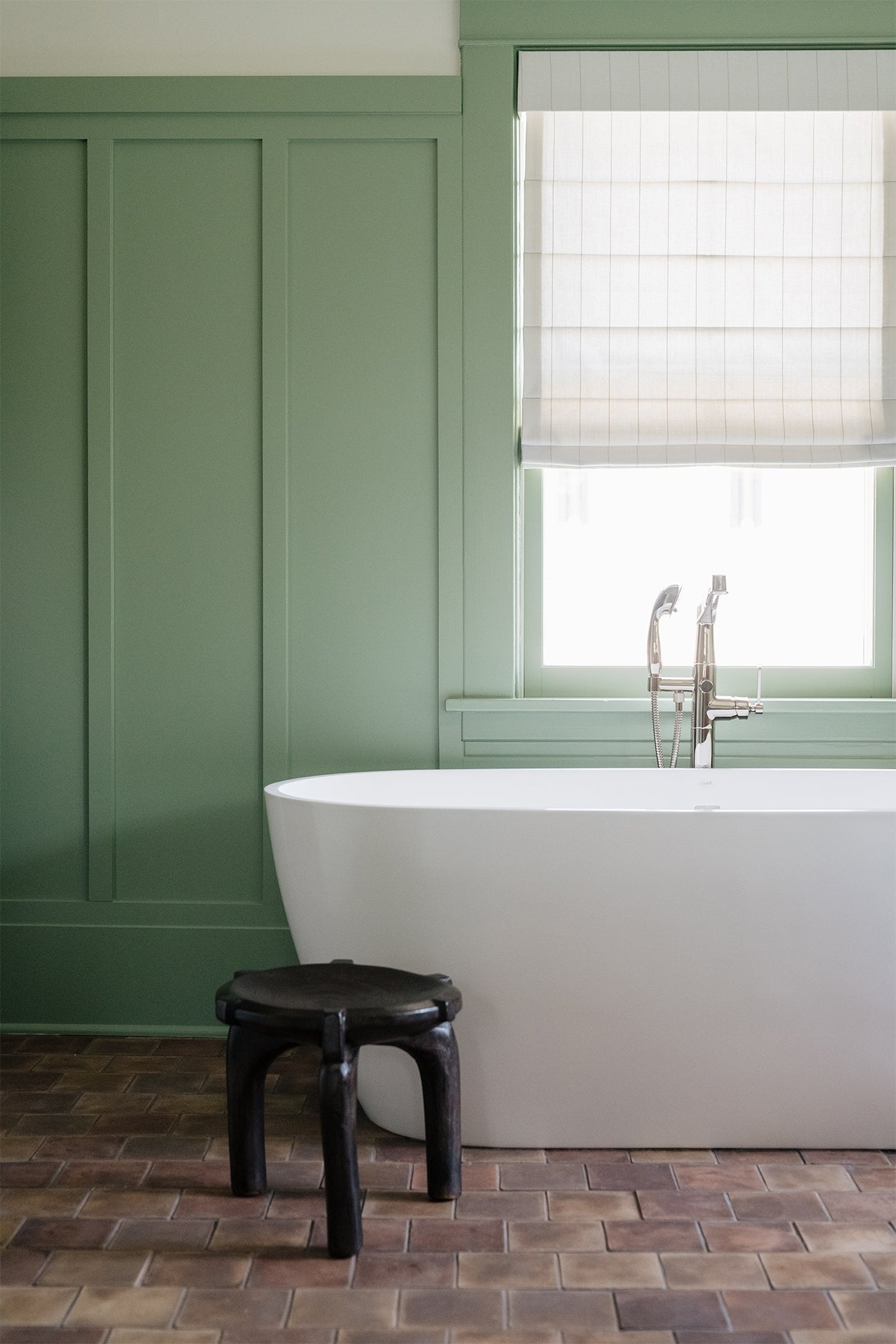 Green bedroom with soaking tub