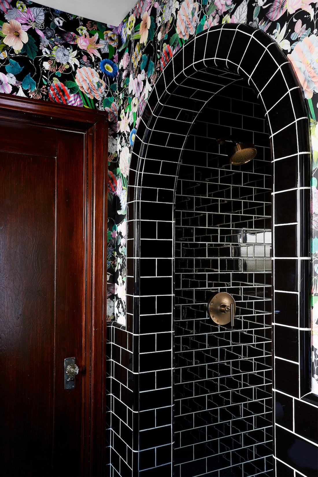 black tile in bathroom archway