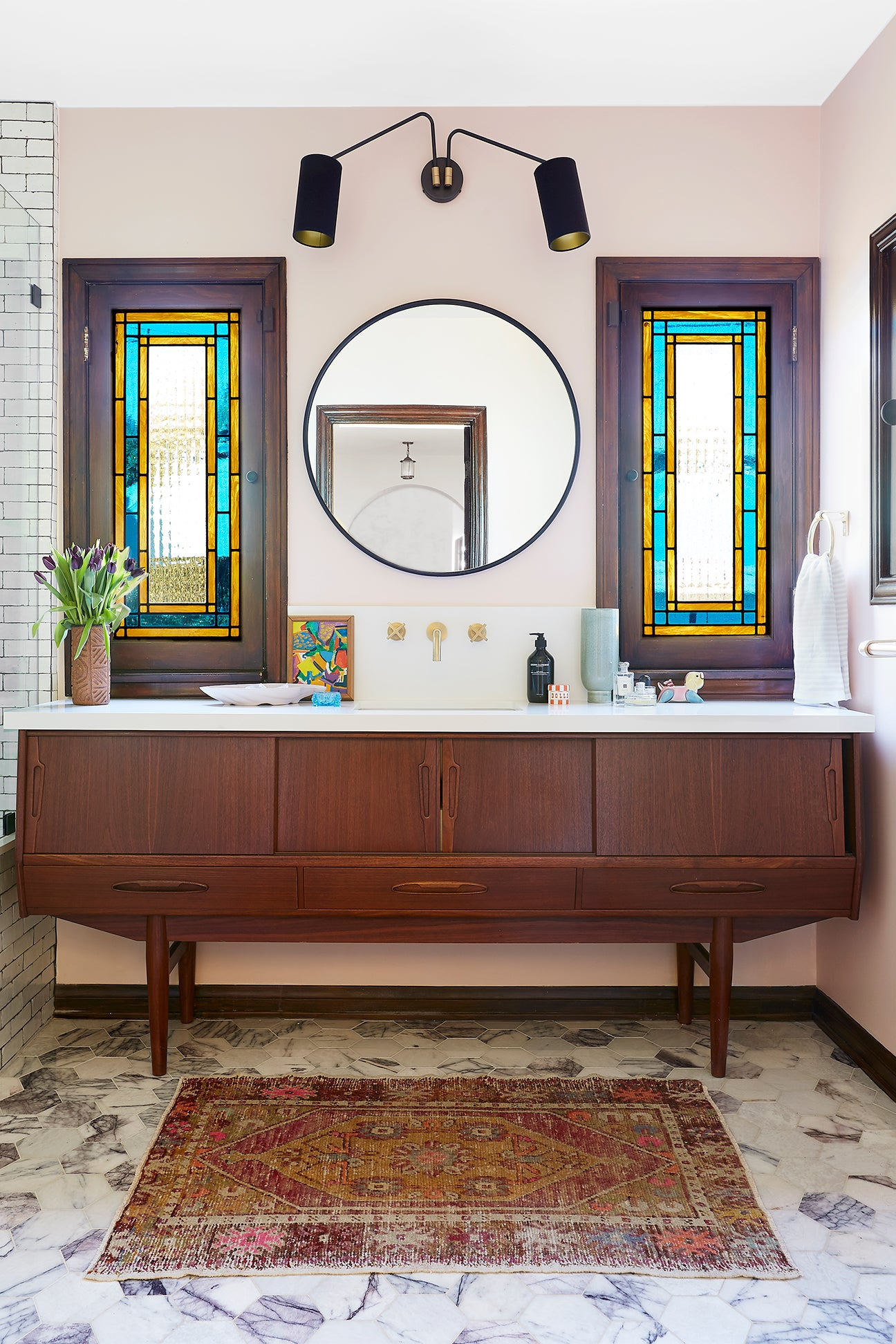 pink bathroom with stained glass windows