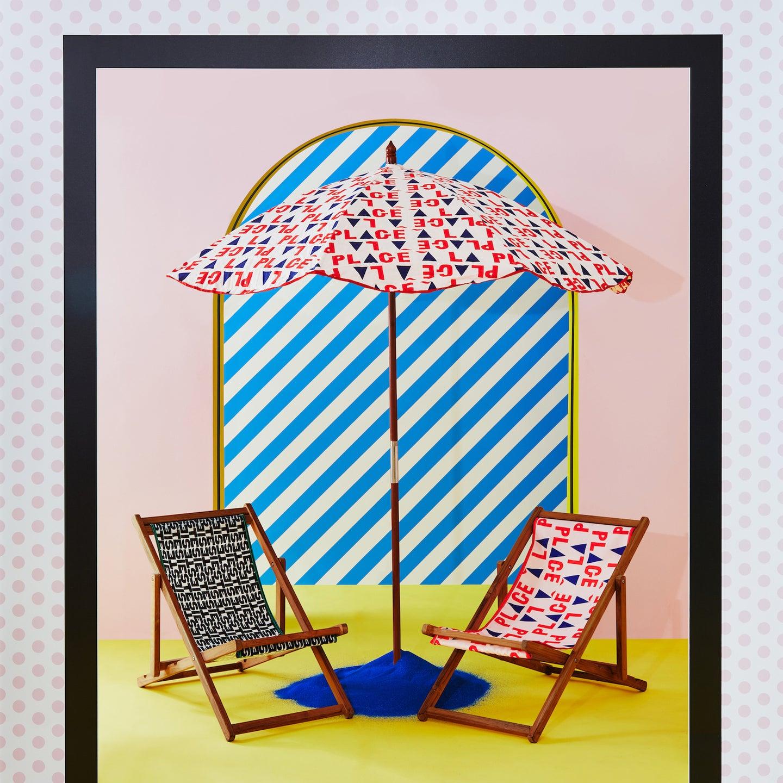 two beach chairs underneath beach umbrella