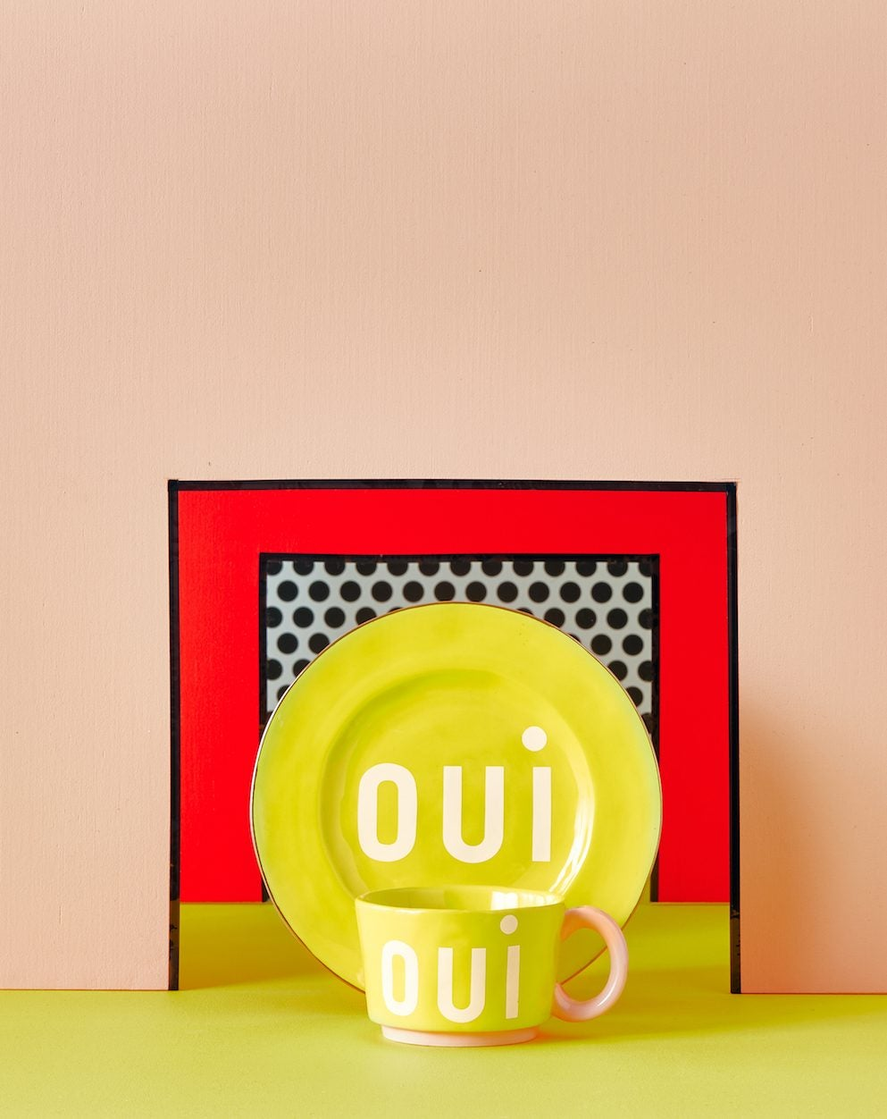 yellow plate in front of pink wall
