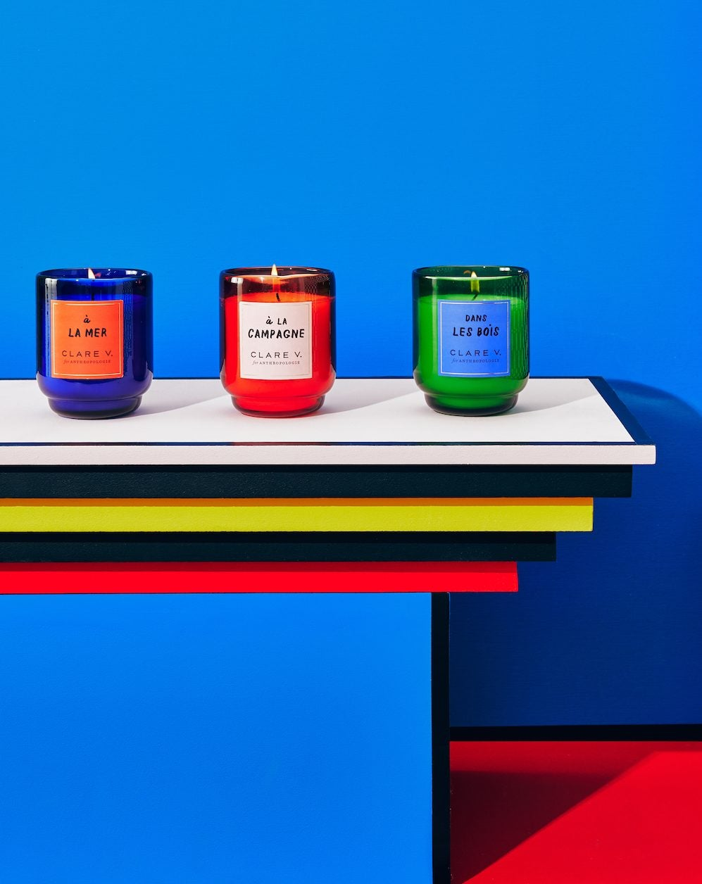 colorful candles in front of blue wall