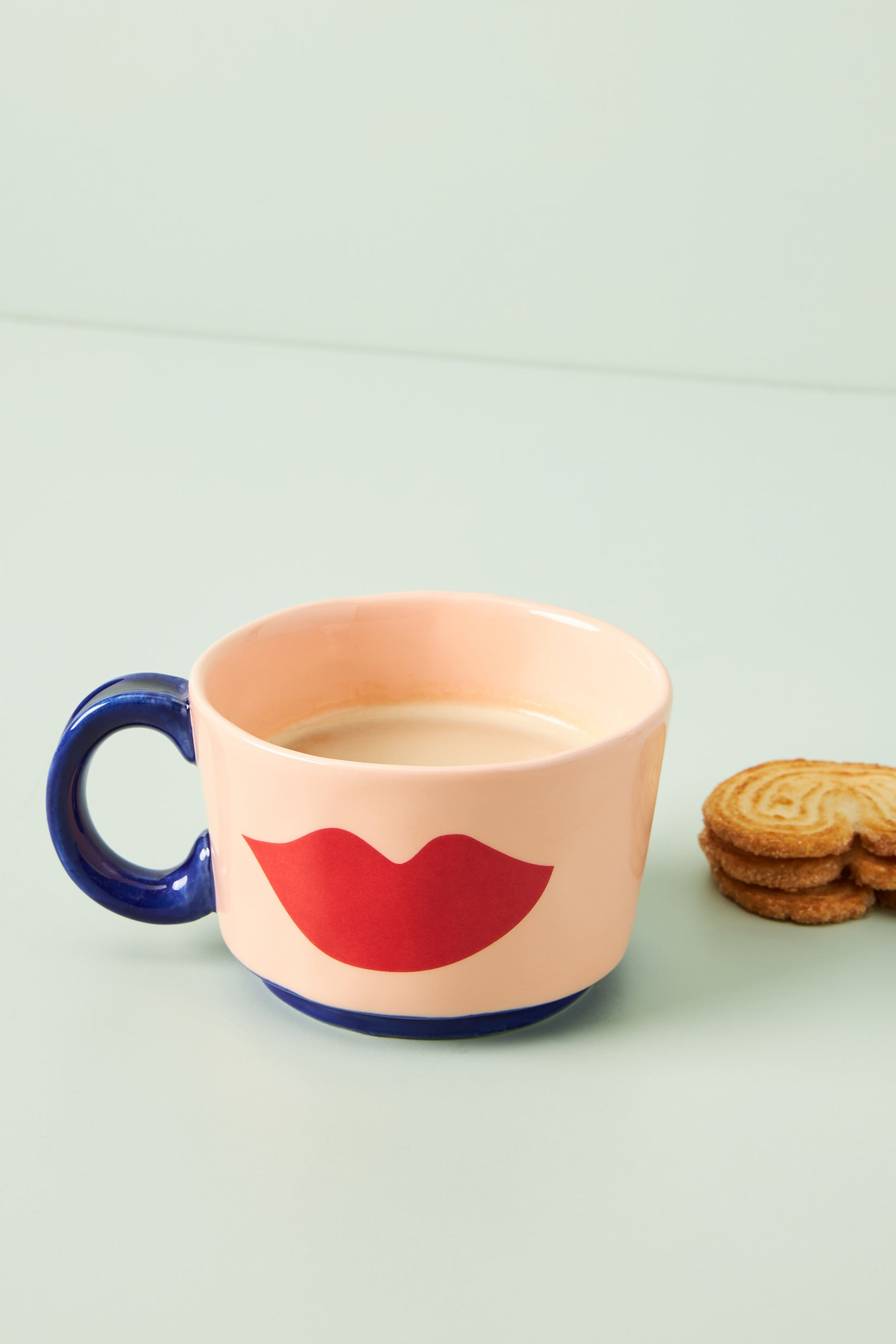 pink mug with red lip print on it