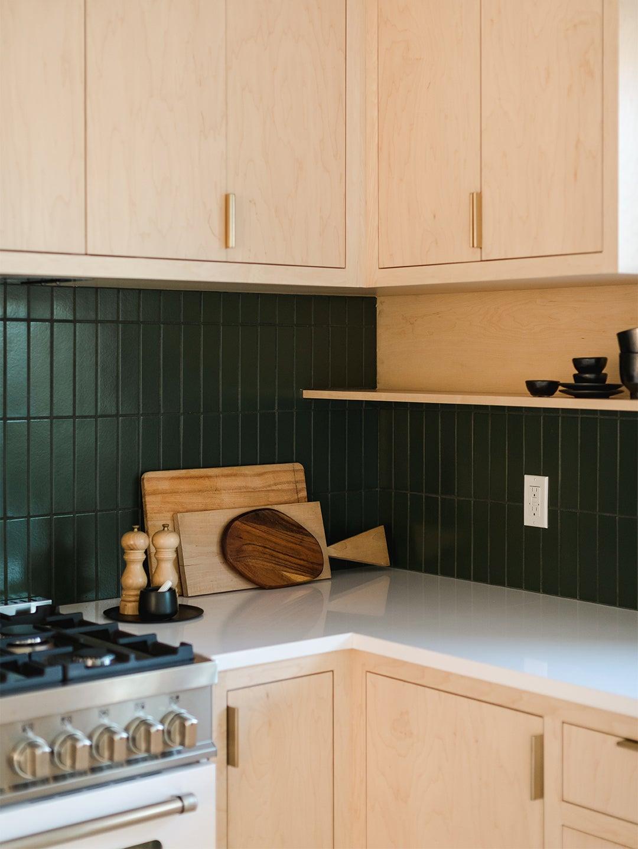 corner of kitchen wiht green tiles