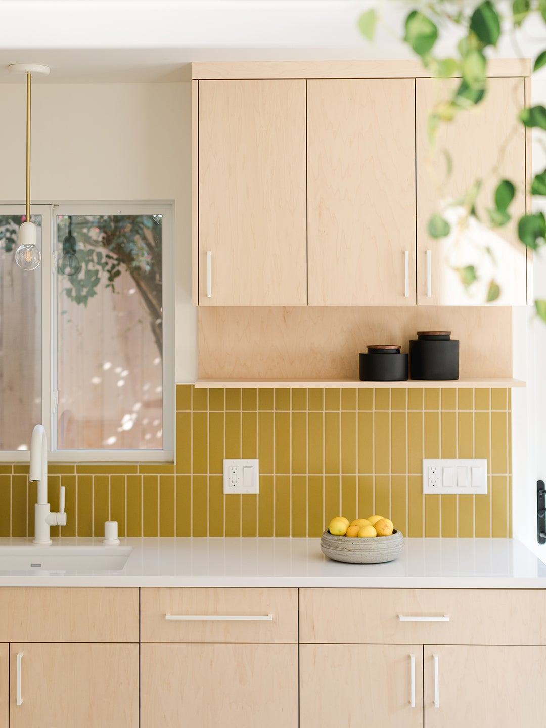 light wood cabinets and mustard yellow backslpahs tile