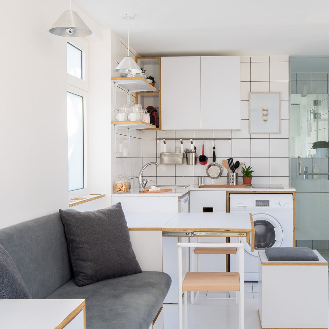 open micro apartment with gray sofa