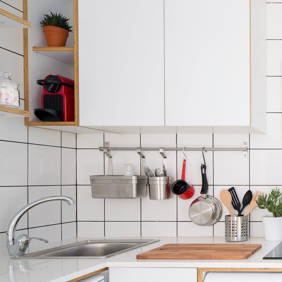 grid tile backsplash and white cabinets