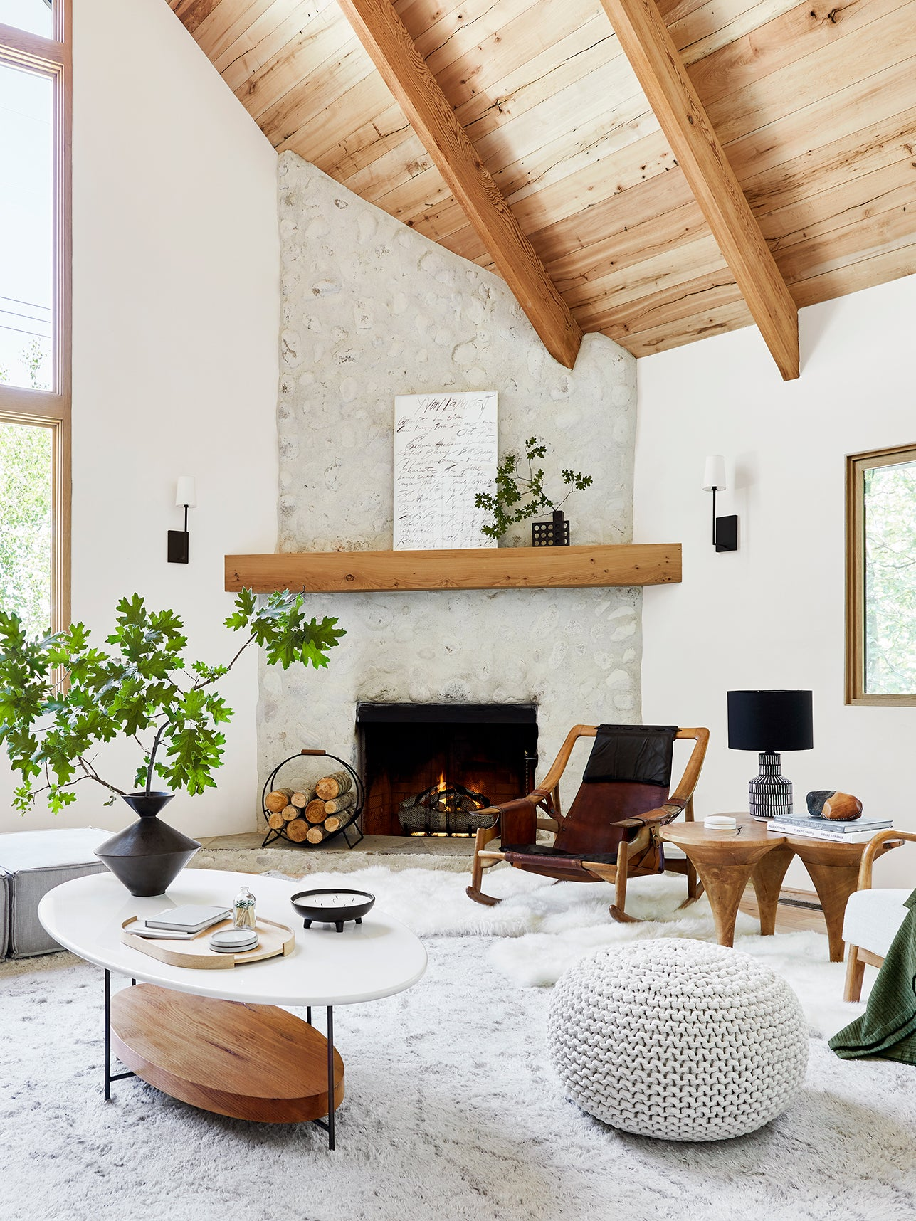 cabin living room with large beamed ceilings