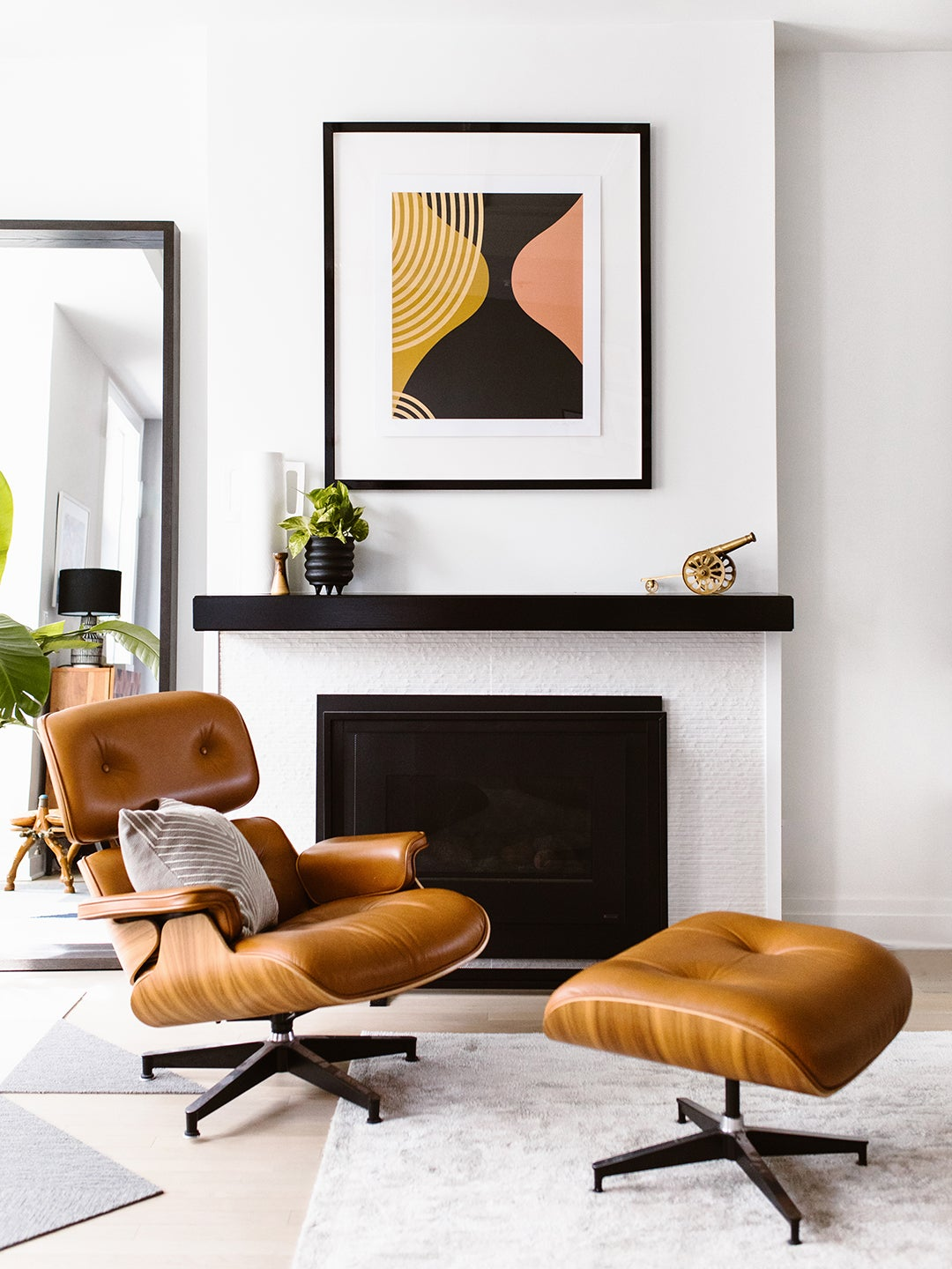 Eames chair in front of fireplace