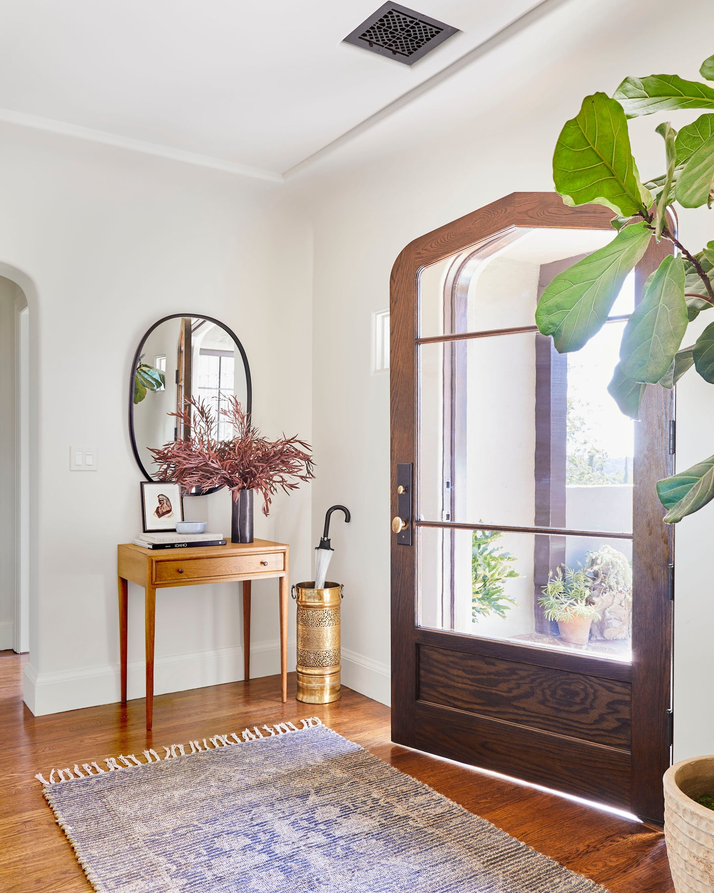 open door with large rug and console table
