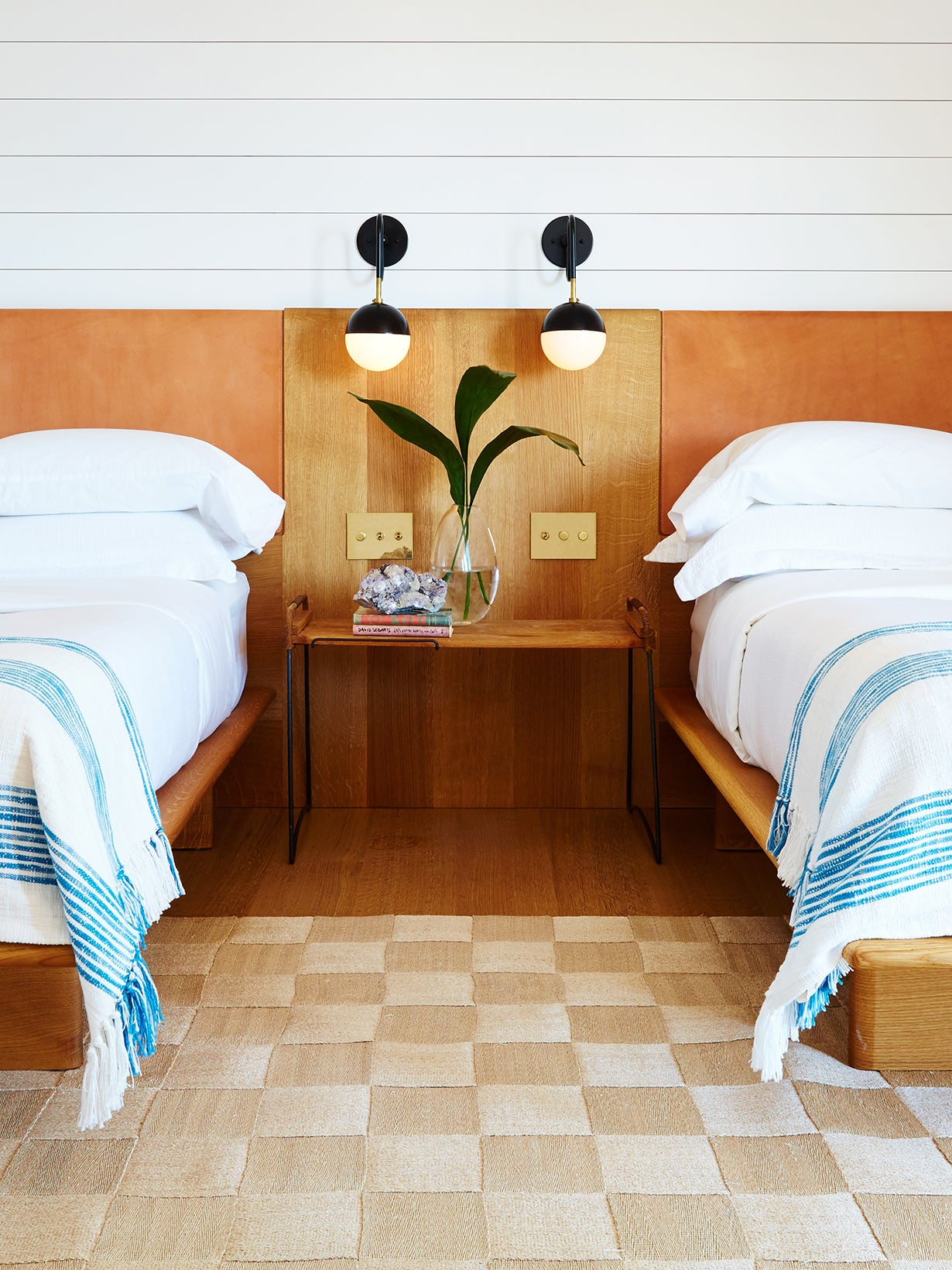 Bedroom with two beds sharing one long headboard