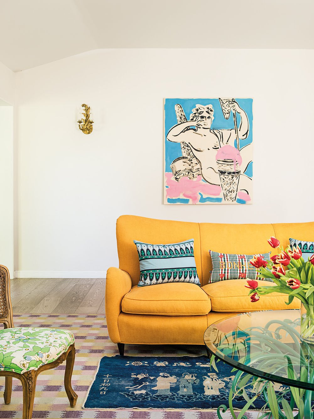 yellow sofa with blue art work