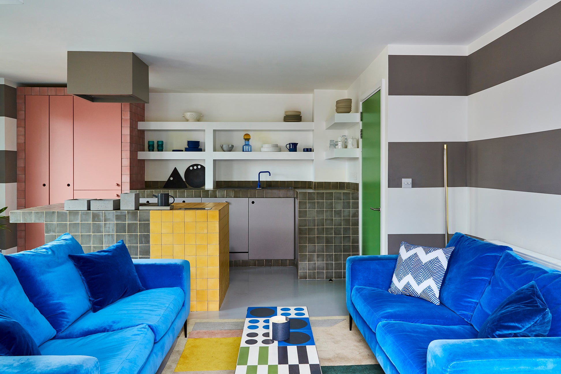 open concept kitchen living room with blue sofas