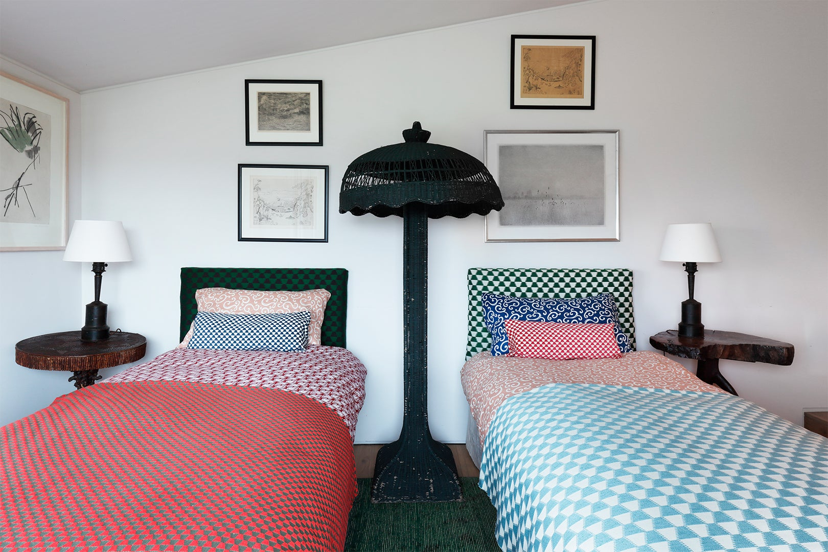 Two beds with mixed-and-matched bedding
