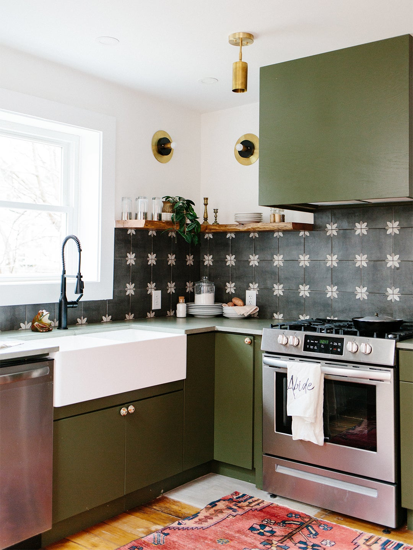 green kitchen with graphic black and white backsplash